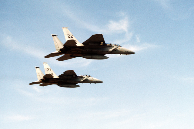 A right side view of two F-15 Eagle aircraft in flight during training exercise Cope North '83-1. The F-15s were deployed from Kadena Air Base, Japan, to participate in the exercise held at Chitose Air Base