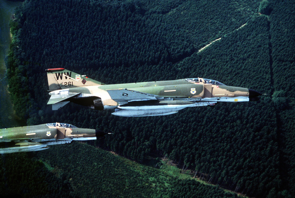 A right side view of two F-4 Phantom II aircraft from the 563rd Tactical Fighter Squadron, George Air Force Base, California, in flight during Exercise Reforger '81