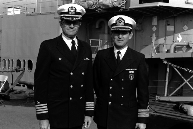 A US Navy officer and the Turkish Naval Attache to the United States, right, pose together during the combined decommissioning and transfer ceremony for the destroyer USS ORLECK (DD 886). After decommissioning, the ship will be transferred to the Turkish Navy and renamed the TCG YUCETEPE (D-345)