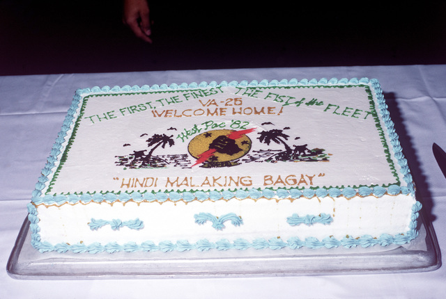 A view of the decorative cake at the welcome home ceremony for A-7E Corsair II aircraft pilots. The pilots, from the Light Attack Squadron 25 (VA-25) and 113 (VA-113), return from aboard the aircraft carrier USS RANGER (CV-61)