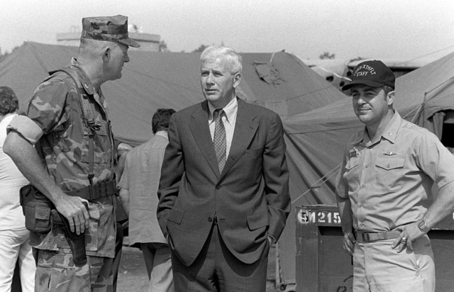 American Ambassador to Lebanon, Robert Sherwood Dillon, center, speaks to Colonel James M. Mead while awaiting the arrival of the Assistant Secretary of Defense at Beirut International Airport. Marines have been deployed here to participate in a multinational peacekeeping operation