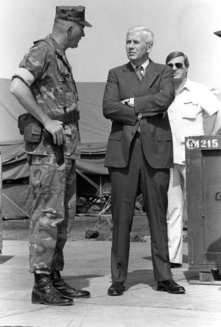American Ambassador to Lebanon, Robert Sherwood Dillon, speaks with Colonel James M. Mead, 32nd Marine Amphibious Unit commander, while awaiting the arrival of the Assistant Secretary of Defense at Beirut International Airport