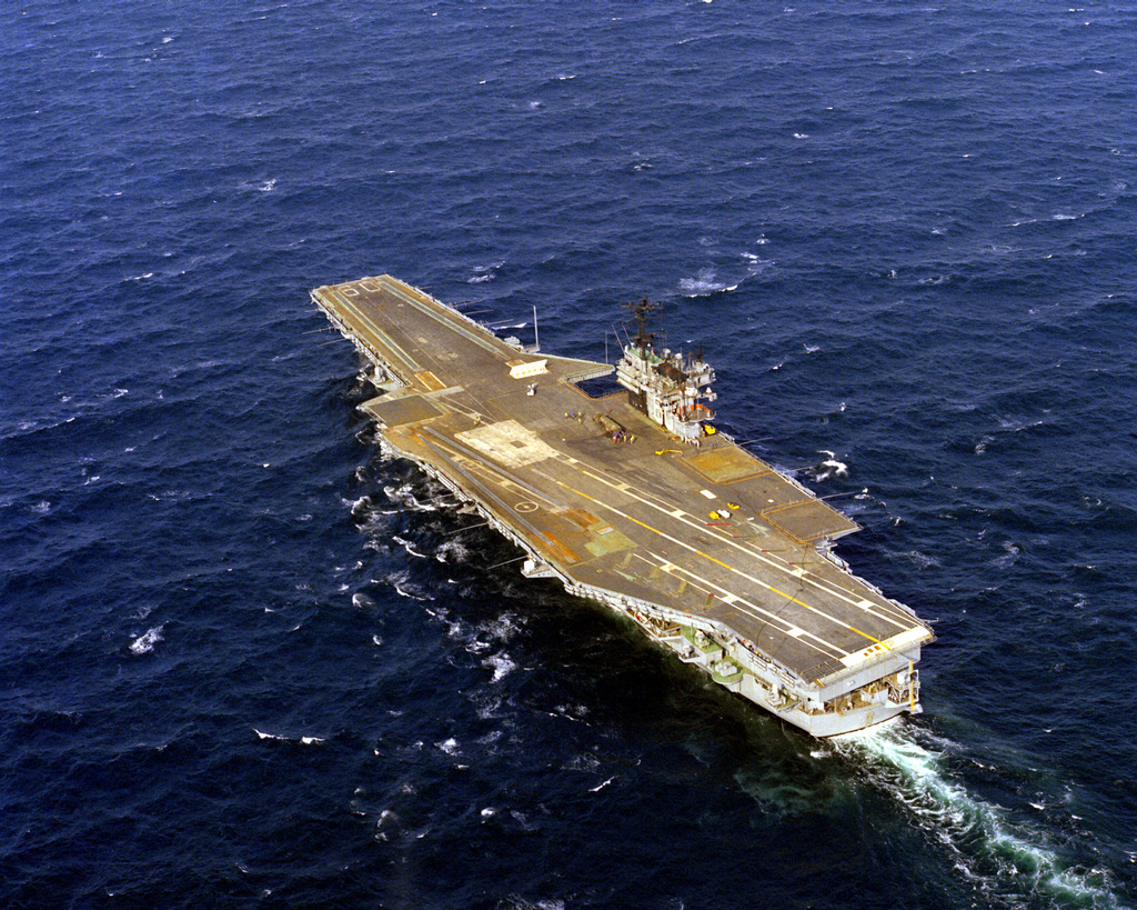 An aerial port quarter view of the aircraft carrier USS SARATOGA (CV-60) underway