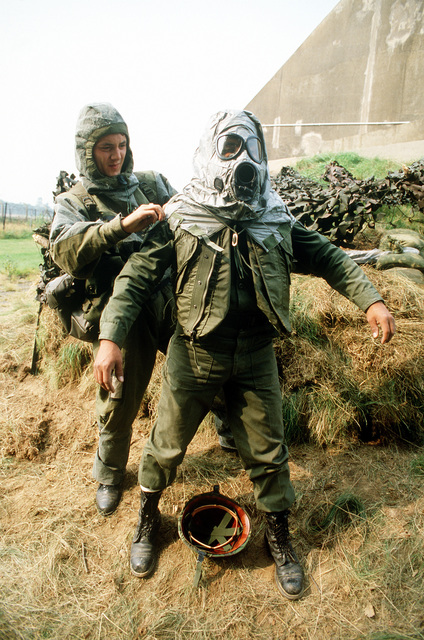 Army personnel from the 4th Infantry Division wear protective gear against chemical warfare during Exercise Reforger '81