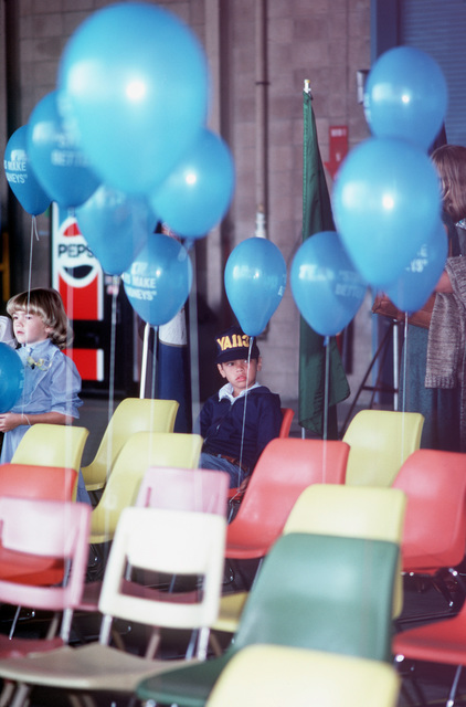 Children hold balloons at the welcome home ceremony for A-7E Corsair II aircraft pilots. The pilots, from the Light Attack Squadrons 25 (VA-25) and 113 (VA-113), return from aboard the aircraft carrier USS RANGER (CV-61)
