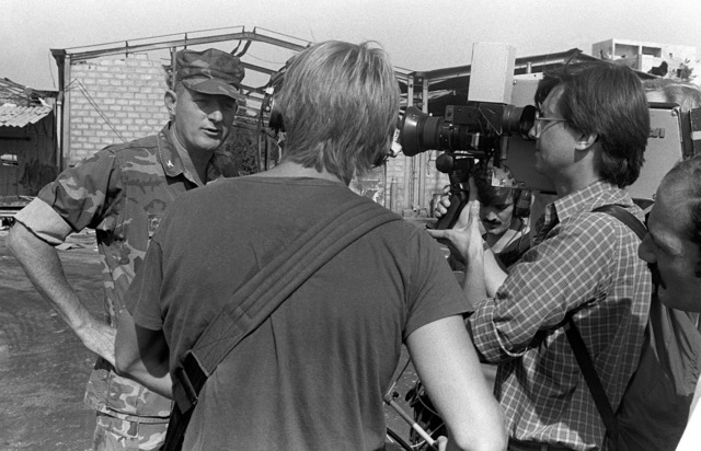 Colonel James M. Mead, 32nd Marine Amphibious Unit commander, is interviewed by the press at Beirut International Airport. The first deployment of Marines is arriving to participate in a multinational peacekeeping operation