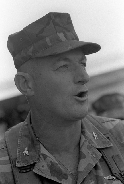 Colonel James M. Mead, 32nd Marine Amphibious Unit commander, supervises the arrival of food supplies for Marines deployed here to participate in a multinational peacekeeping operation