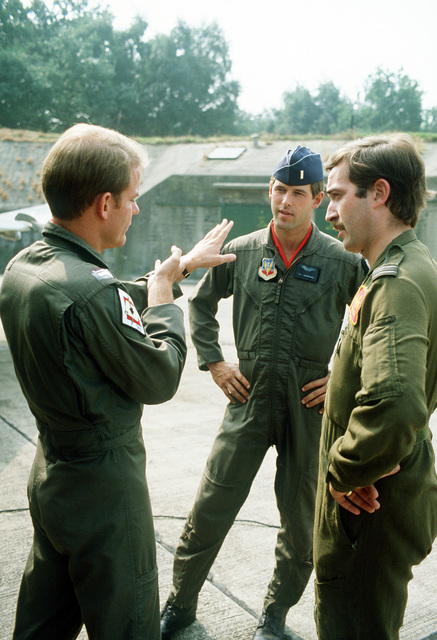 F-4 Phantom II aircraft pilots from the 563rd Tactical Fighter Squadron, George Air Force Base, California, discuss the staging of support mission with a British officer during Exercise Reforger '81