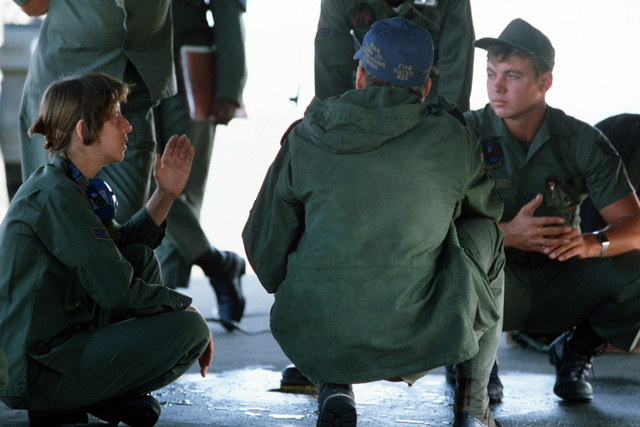 Members of the ground crew discuss operations during training exercise Cope North '83-1. The training exercise is being held at Chitose Air Base
