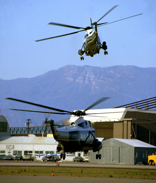 Two Marine Helicopter Squadron 1 (HMX-1) VH-3D Sea King helicopters prepare to land during the arrival of President Ronald W. Reagan
