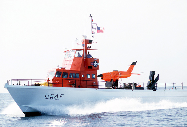 A port bow view of a U.S. Air Force missile recovery ship (MR-85 1603), operated by the 82nd Technical Assistance Team/Tactical Training Wing, returned to base with a Firebee drone secured to the deck. The drone was recovered from the water after serving as a target for aircraft participating in the air-to-air combat training exercise William Tell '82