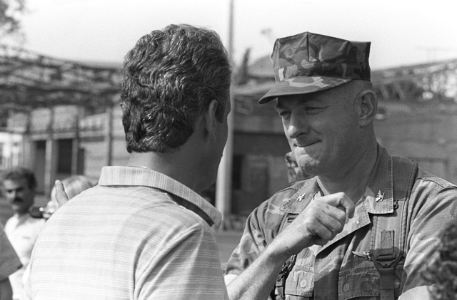 Colonel Mead, 32nd Marine Amphibious Unit commander, talks with a Lebanese civilian while awaiting a shipment of food supplies. Marines from the 32nd MAU have been deployed here to participate in a multinational peacekeeping operation