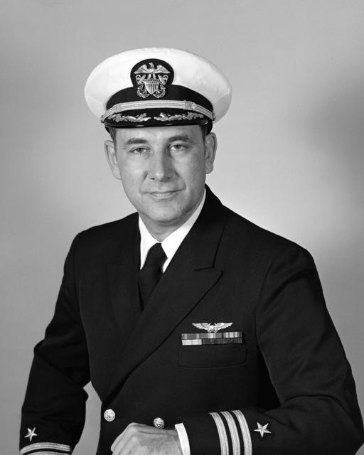 Commander J. S. Dickenson, USN (covered)