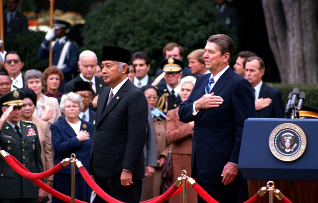 President Ronald W. Reagan stands with Indonesian President Suharto during an armed forces full hornor arrival ceremony