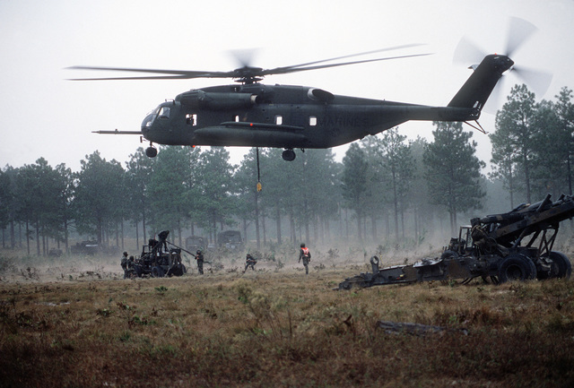 A CH-53E Sea Stallion helicopter prepares to airlift a M-198 155mm howitzer. The 10th Marine Regiment are here for a field training exercise with the M-198