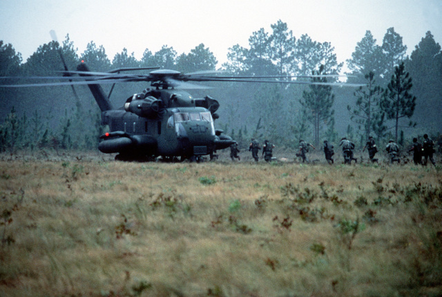 Men of the 10th Marine Regiment are airlifted by CH-53E Sea Stallion helicopter to the Fort Bragg Army base for field training with the M-198 155mm howitzer