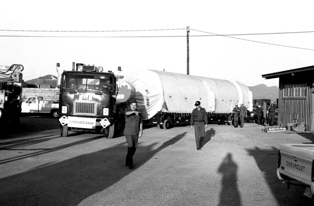 Personnel of the 390th Missile Maintenance Squadron direct the arrival of a Titan II first stage at the Southern Pacific Railyard. This is the first Titan II missile to be removed from duty with the 390th Strategic Missile Wing, Davis-Monthan Air Force Base, Ariz