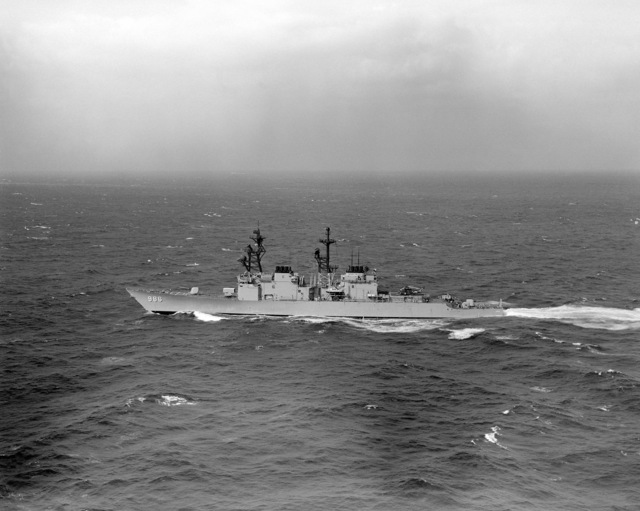 Aerial port beam view of the Spruance class destroyer USS HARRY W. HILL (DD 986) underway. (SUBSTANDARD)