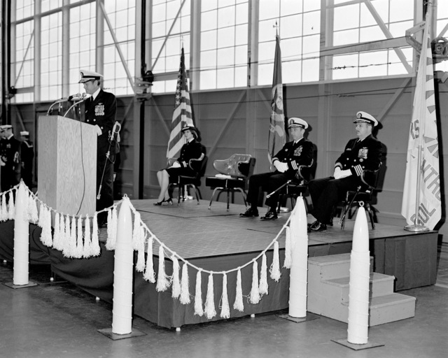 CAPT David D. Williams, left, and CDR Rodney C. Franz cut the cake at the conclusion of the ceremony in which CAPT Williams relieved CDR Franz as commanding officer of Attack Squadron 128 (VA-128)