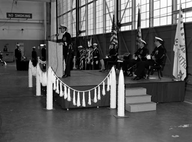 CDR Rodney C. Franz speaks during the change of command ceremony in which he is being relieved as commanding officer of Attack Squadron 128 (VA-128), by CAPT David D. Williams