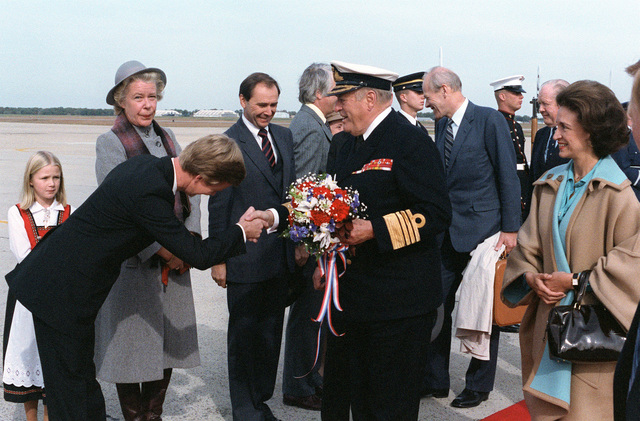 Norway's King Olav V and his entourage are greeted upon their arrival for a visit