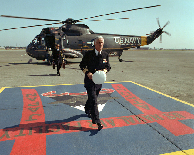 Rear Adm. Crawford Easterling, commander, Naval Air Force, Pacific, walks from an SH-3 Sea King Helicopter upon his arrival for a tour of the facility