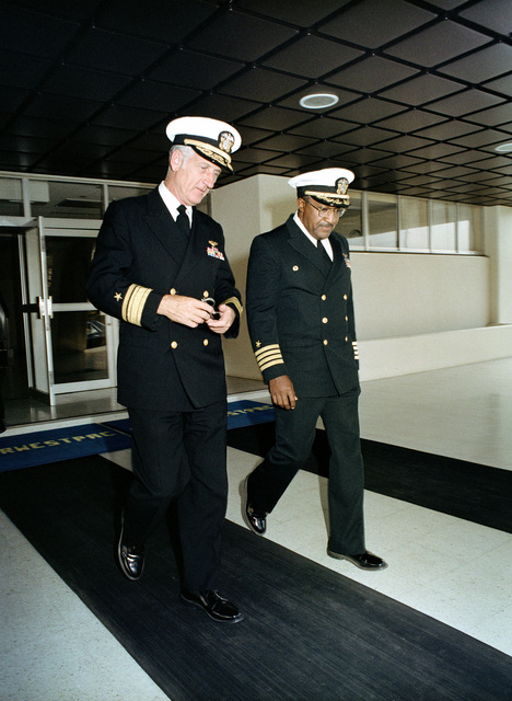 Rear Admiral Crawford Easterling, left, commander, Naval Air Force, Pacific, walks with Captain Brooks, Naval Air Facility's commanding officer, as they depart the facility's headquarters