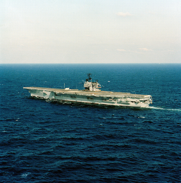 Aerial port beam view of the aircraft carrier USS SARATOGA (CV-60) underway