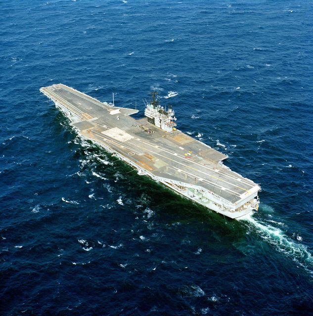 Aerial port quarter view of the aircraft carrier USS SARATOGA (CV-60) underway