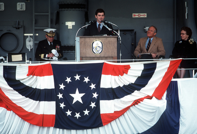 John Gilbride, vice president of the Todd Shipyards, speaks to the audience during the commissioning ceremony for the guided missile frigate USS STARK (FFG-31). On the platform are CMDR Lewin, Rep Joel Pritchard, R-Wash., and the ship's sponsor Mrs. Seamans (left to right)