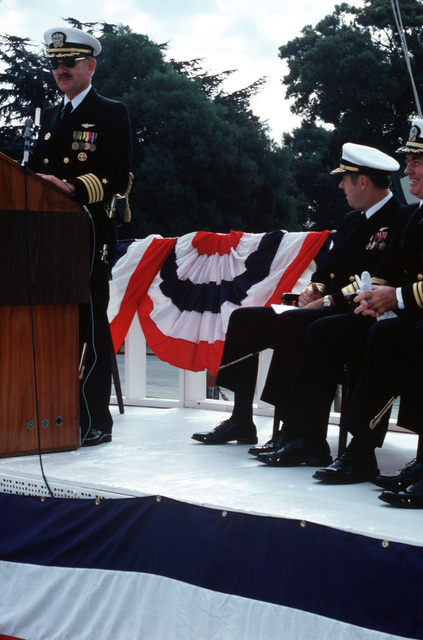 Captain (CAPT) Donald Richmond speaks to the audience after assuming the command from CAPT Norman Campbell at the ceremony