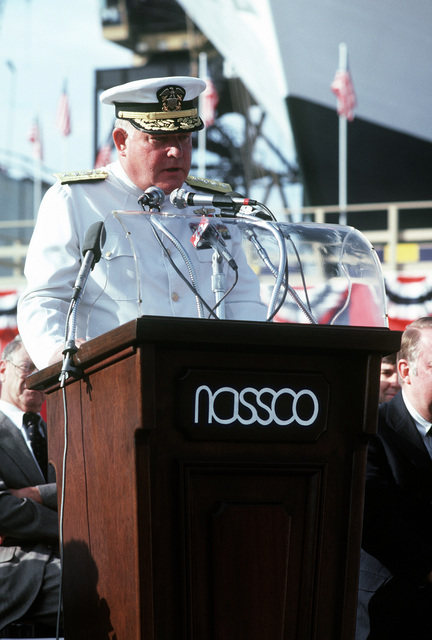 RADM Dempster M. Jackson, deputy commander, Combat Systems, Naval Sea Systems Command, speaks at the launching ceremony for the cable repair ship USNS ZEUS (T-ARC-7). The ship was built by the National Steel and Shipbuilding Company