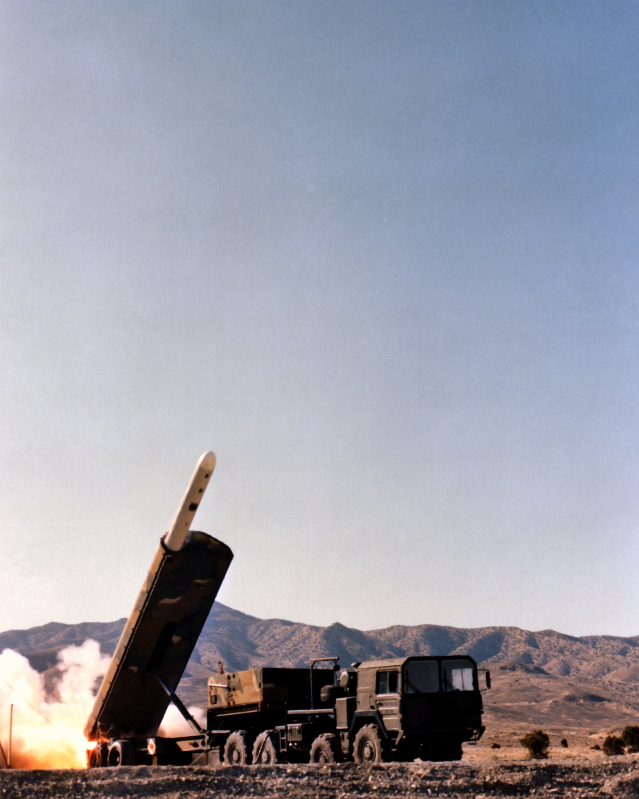A Ground-Launched Cruise Missile (GLCM) begins to emerge from the Transporter-Erector Launcher (TEL) during a test firing