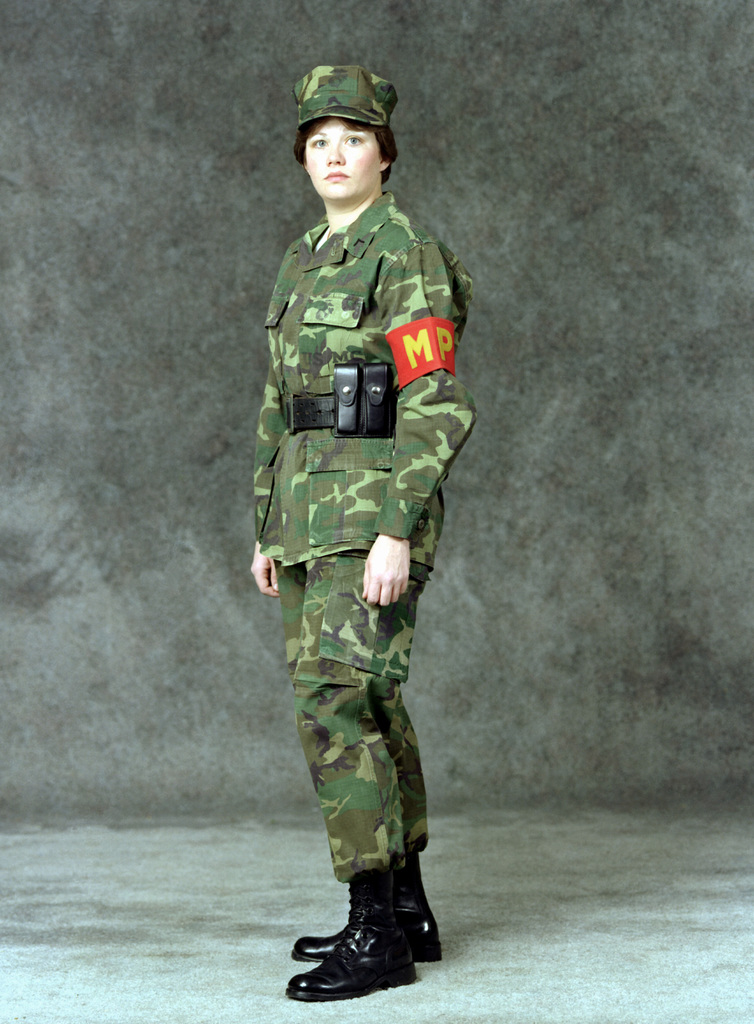 A woman Marine private first class is dressed in a military