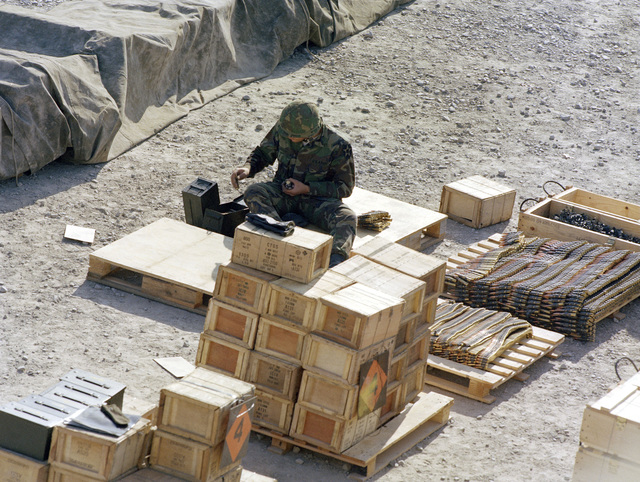 An infantryman loads ammunition clips in preparation for a live fire training exercise on the Boydston Range of the Army Armor Center