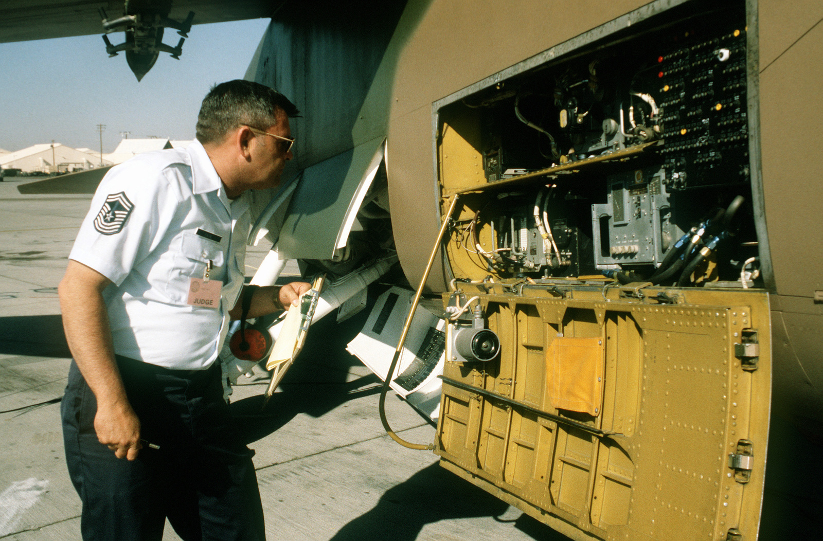 CMSGT Barney Pate, a member of the 81st Tactical Fighter Wing, RAF Brentwaters, England, inspects an A-7D Corsair II aircraft during Operation Gunsmoke '81