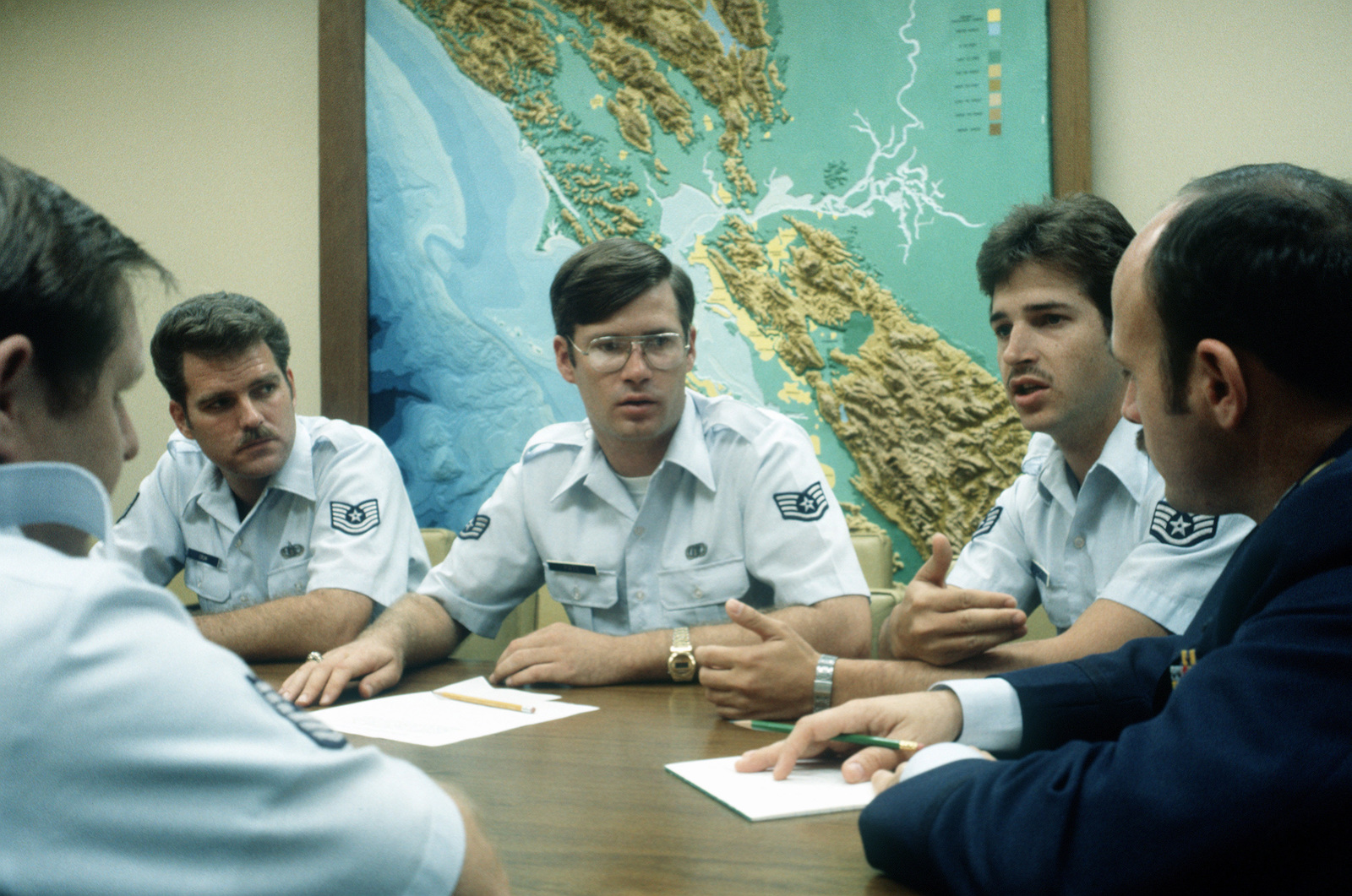 From right to left, MSGT Varner, TSGT Fred Crum, SSGT Michael Pate, SSGT Lichty and LT. Dan D'Innocenti discuss air traffic control operations at the Oakland Airport