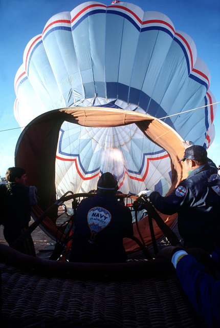 Ignited propane gas is used by the Navy Balloon Team to heat the air inside the balloon as preparations are made for liftoff during the10th anniversary of the Albuquerque International Balloon Fiesta
