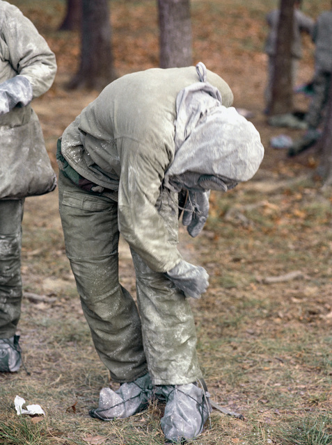 Infantrymen practice decontamination procedures on their chemical warfare gear as part of common task skill testing at the Army Armor Center