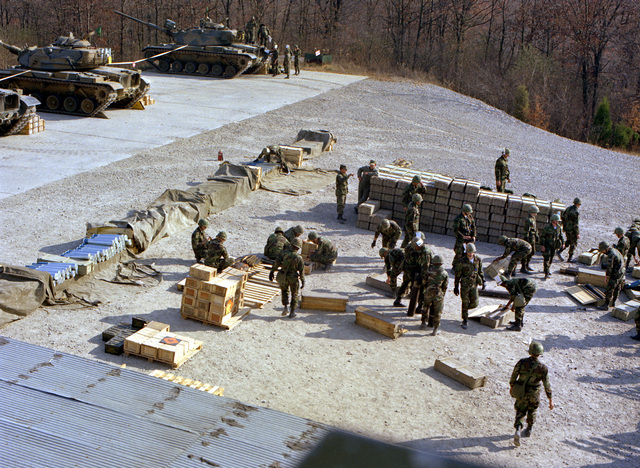 Infantrymen prepare ammunition for a live fire exercise on the Boydston Range at the Army Center