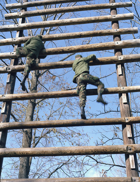 Infantrymen work through an obstacle on the confidence course during their training at the Army Armor Center