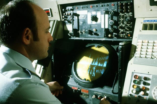 LT. Dan D'Innocenti, an air traffic controller, monitors an approach radar scope at the Travis Air Force Base Control Center