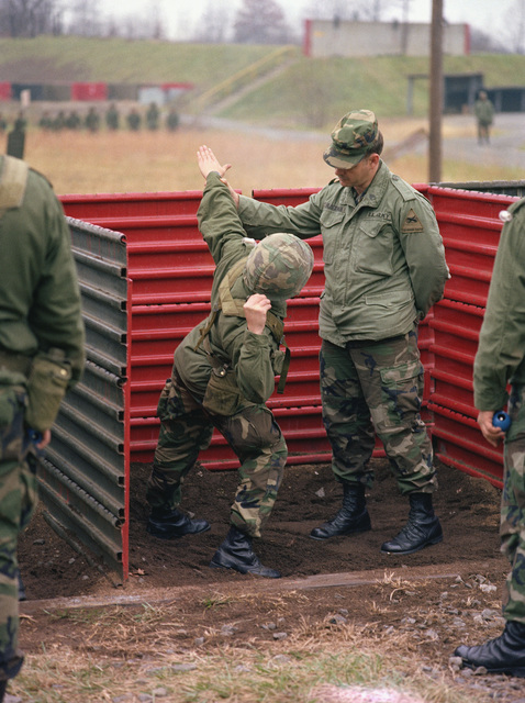 Members of the 1ST Brigade undergo hand grenade training at the Army Armor Center