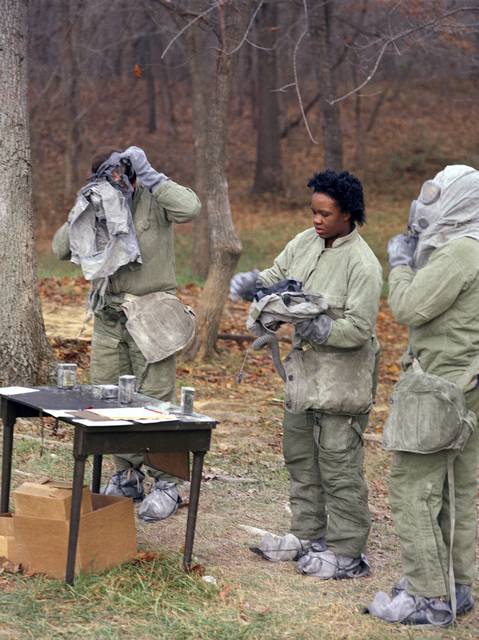 Soldiers practice decontamination procedures on their chemical warfare gear as part of common task skill testing at the Army Armor Center