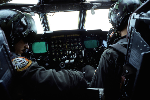 The crew in the cockpit of a B-52H Superfortress aircraft fly toward Darwin, Australia, where they will participate in Glad Customer '82 exercises