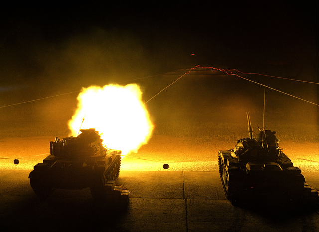 The main gun of an M60A1 tank is fired during a night firing exercise at the Boydston Range of the Army Armor Center