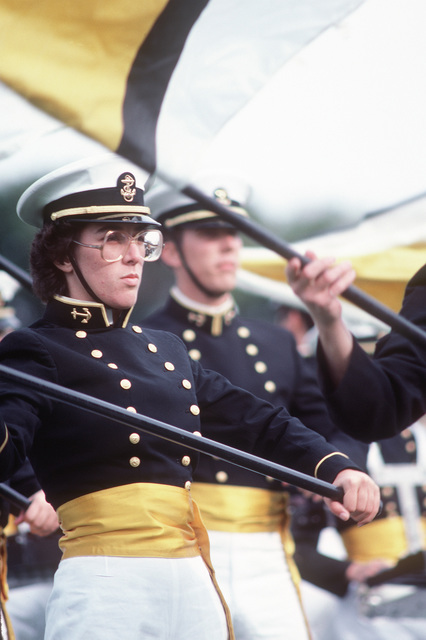 The US Naval Academy drill team performs during a football game half time at the US Navy-Marine Corps Memorial Stadium