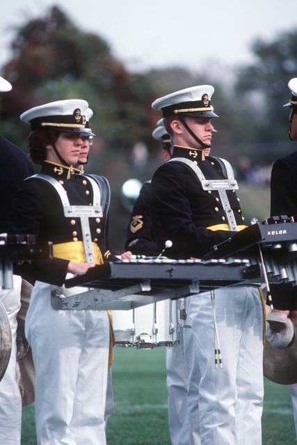 The US Naval Academy drum and bugle corps performs during a football game half time at the US Navy-Marine Corps Memorial Stadium
