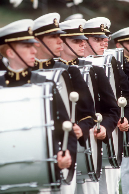 US Naval Academy drum and bugle corps perform during a football game half time at the US Navy-Marine Corps Memorial Stadium