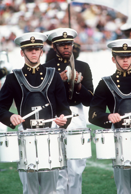 US Naval Academy drum and bugle corps performing during a football game half time at the US Navy-Marine Corps Memorial Stadium